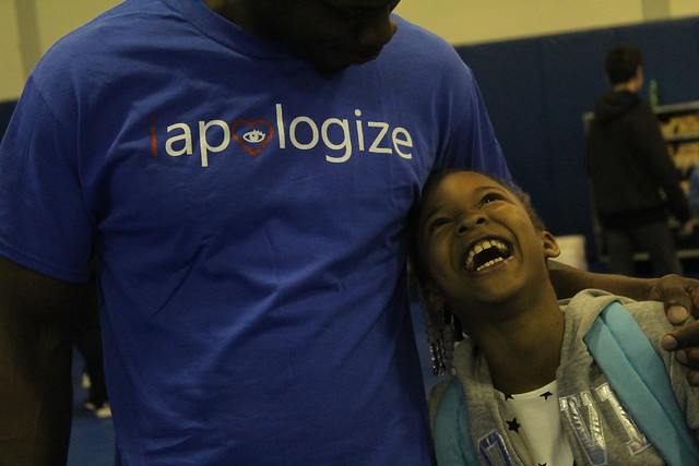 Sullivan jokes with Zoe Stewart, 8, at the Southwest Community Center. | Rachel George, Staff Photo