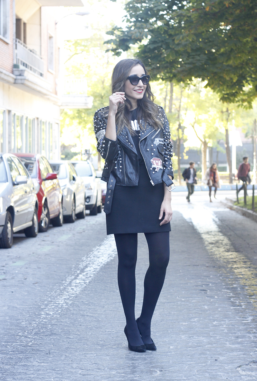Leather jacket with studs and patches black skirt heels style fashion outfit01