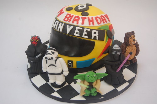 Such a boys' cake, this one! Made particularly personal to the recipient with the use of his name and age on the helmet and his very favourite Star Wars characters - Darth Maul, Stormtrooper, Yoda, Kylo Ren and Chew Bacca! The Motorcycle Helmet Cake - from £65 (plus £5 for each modelled character).