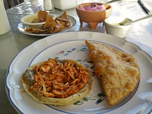 From left: cochinita pibil panucho and lechón con chicharrón empanada