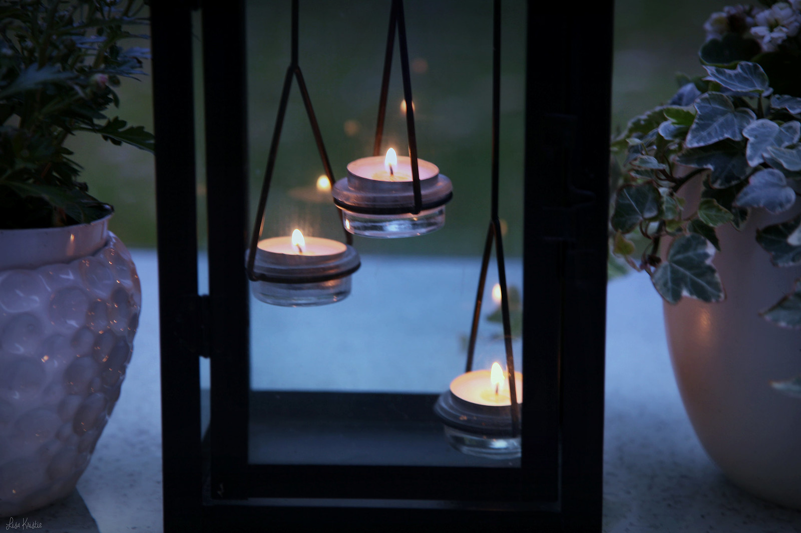 dark evening patio candles tea lights table outside outdoor potted plants fall dusk