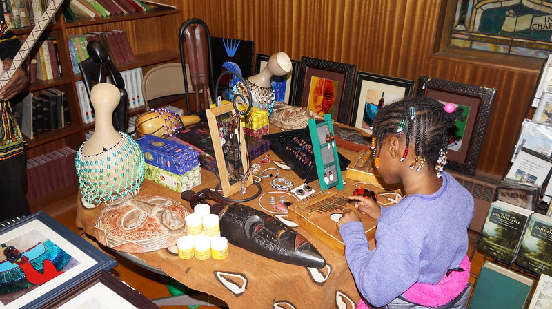 A girl at the conference views traditional African art. Speakers at the conference said remembering the past is vital to building and shaping the future. | Photo Provided