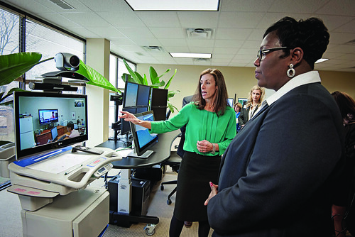 Mississippi Rural Development State Director Trina N. George and Dr. Kristi Henderson, Director of Telehealth and Chief Advanced Practice Officer at University of Mississippi Medical Center demonstrating a telehealth system