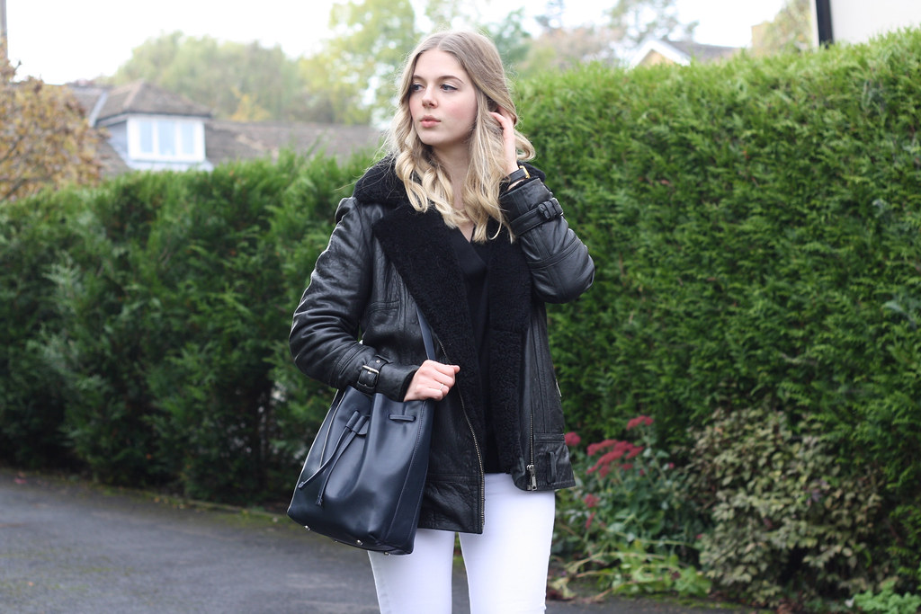 Topshop white Jamie jeans, Whistles Everett bucket bag and Whistles black leather jacket