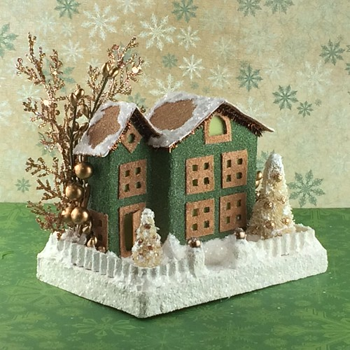green and brown Putz house with copper embellishments