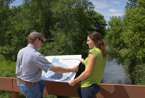 ARS soil scientist Mark D. Tomer and technician Sarah Porter reviewing a map showing results from a new toolset