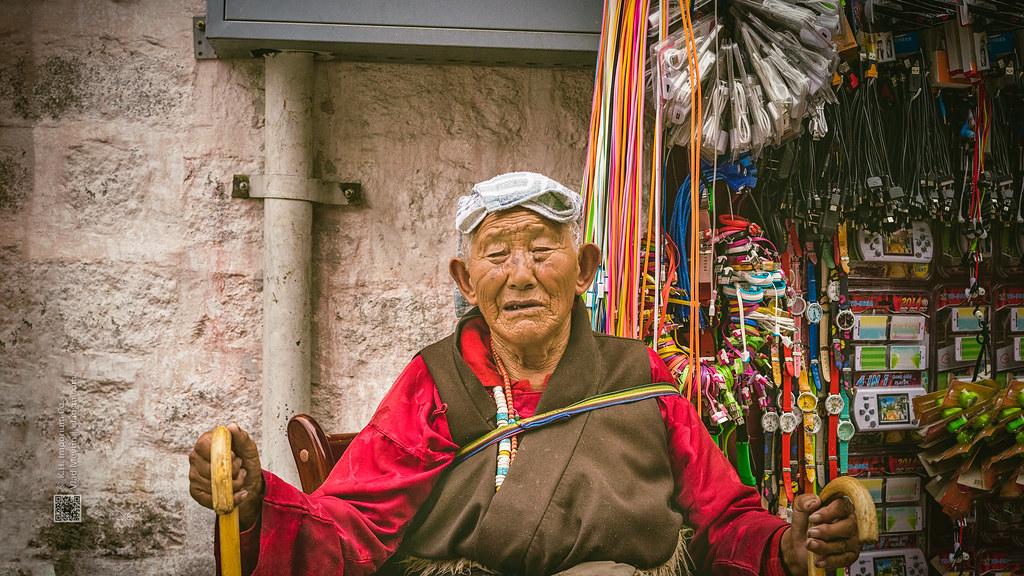 Tibet, candid shot of an old man sitting beside the street shop (Lhasa, China), 06-2016, 81 (Vlad Meytin, vladsm.com)