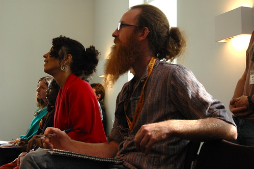 Participants at a conference sit and listen to a speaker