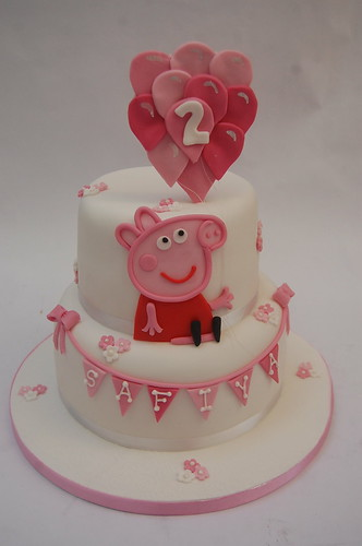 We absolutely loved creating this incredibly pretty Peppa Pig Cake! The Peppa Pig Cake with Balloons - from £80.
