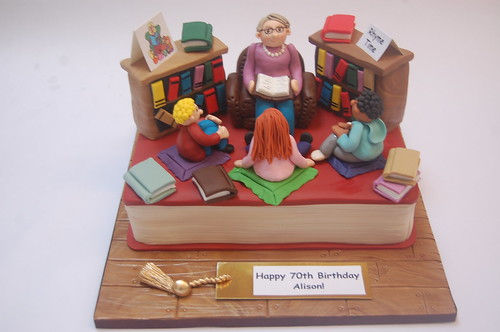 Such fun to create! And with so many nods to the library theme - from the shelves to the books, from the bookmark to the rapt children! Perfect for a librarian! The Rhyme Time Library Cake - from £80.