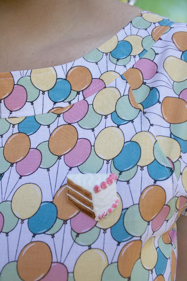cake brooch balloon dress