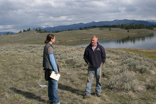 Jim Stone, Montana Rancher, and Bridget Collins, former Association of Fish and Wildlife Agencies Agriculture Policy Coordinator, discuss conservation programs near Jones Lake on the Rolling Stone Ranch. Photo by Dave Smith.