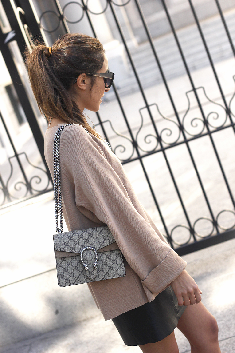 nude sweater leather skirt heels sunnies gucci bag fashion outfit style13