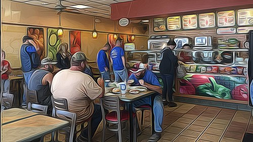 Customers line up at a Subway sandwich shop for National Sandwich Day