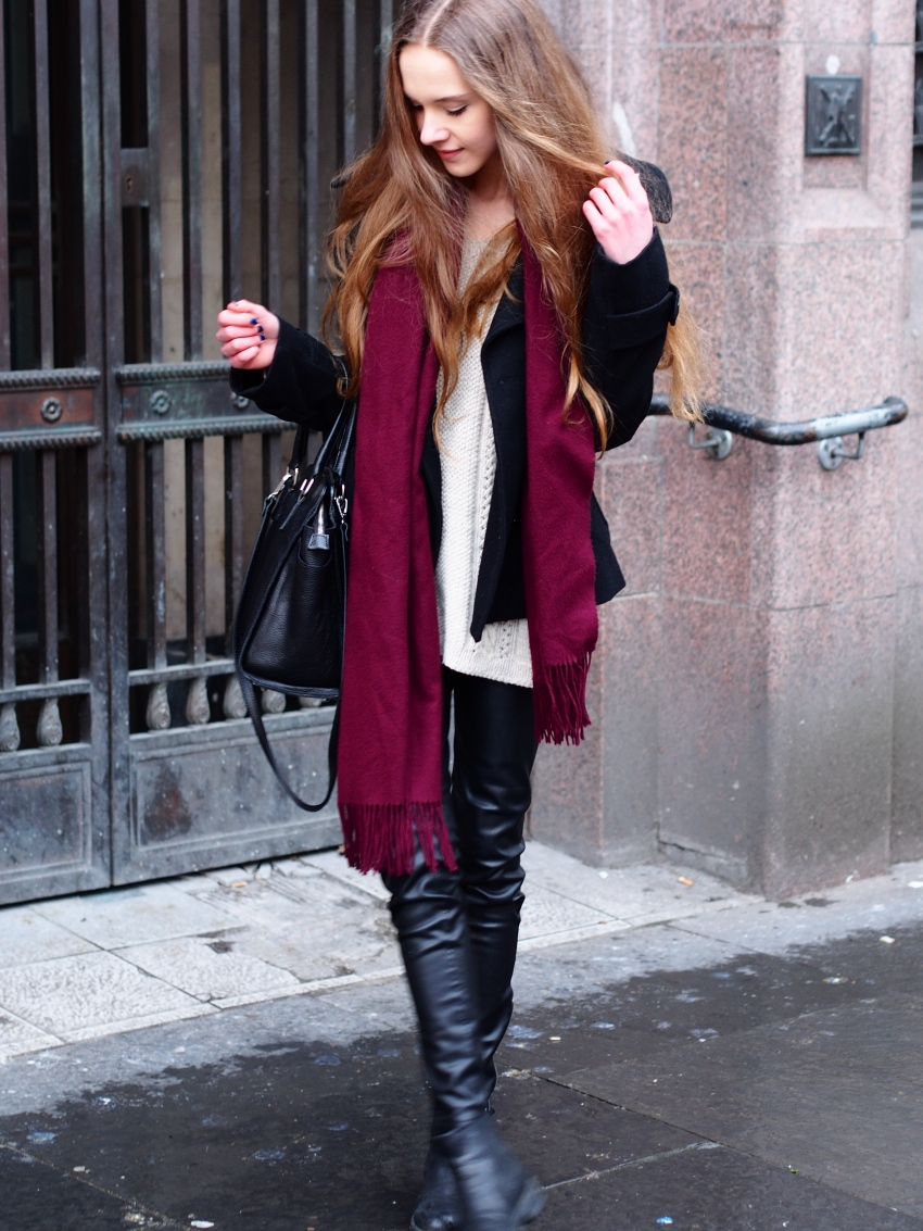 layering with sweater and faux leather pants