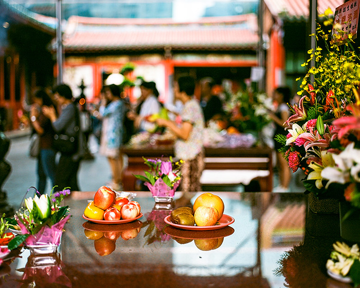 © 2016. Fruit and flowers on the tables at Lungshan Temple of Manka. Tuesday, Sept. 6, 2016. Ektar +2, Pentax 6x7.