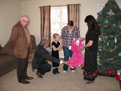 Rural Housing Service Administrator Tony Hernandez giving a Holiday gift to the Weber's in their new home