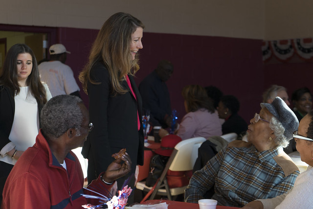 Colleen Deacon, democratic candidate for the 24th Congressional District, visits with South Side residents during the Dunbar Election Day breakfast fundraiser held Nov. 8. | Marianne Barthelemy, Staff Photo