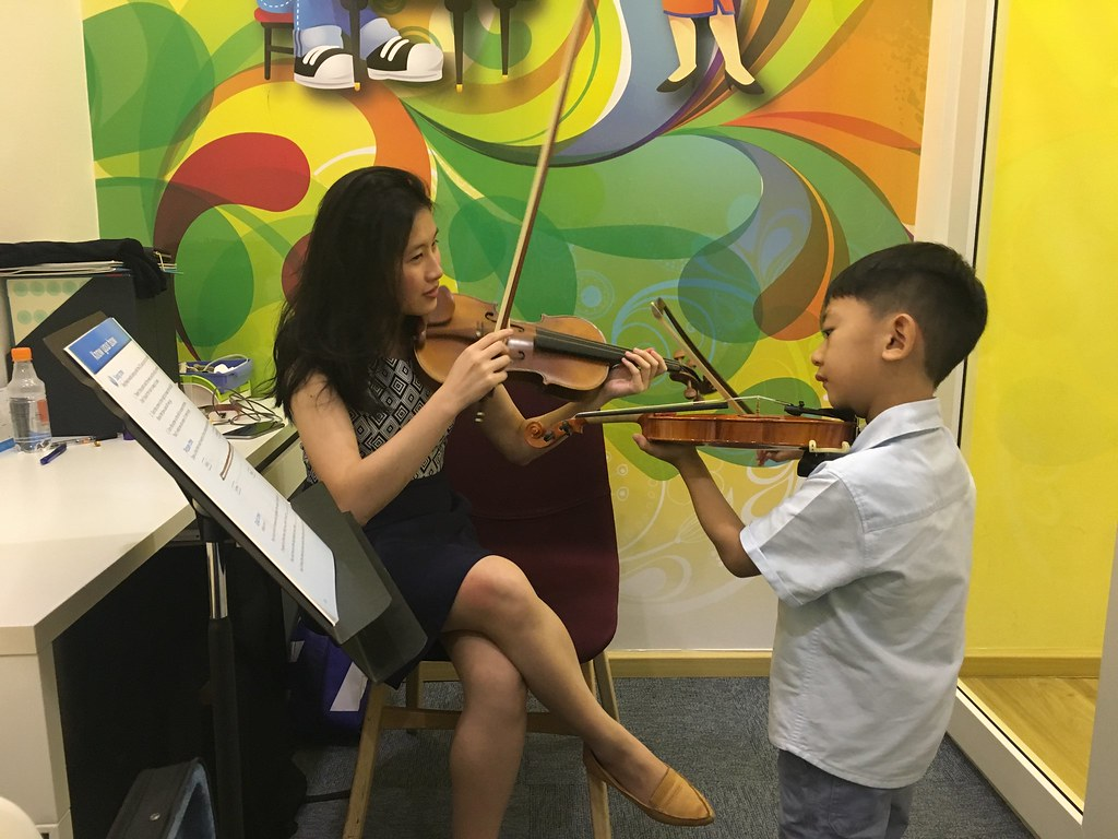 Asher has progressed to learning how to use the bow on the violin, but no fingering, just yet.