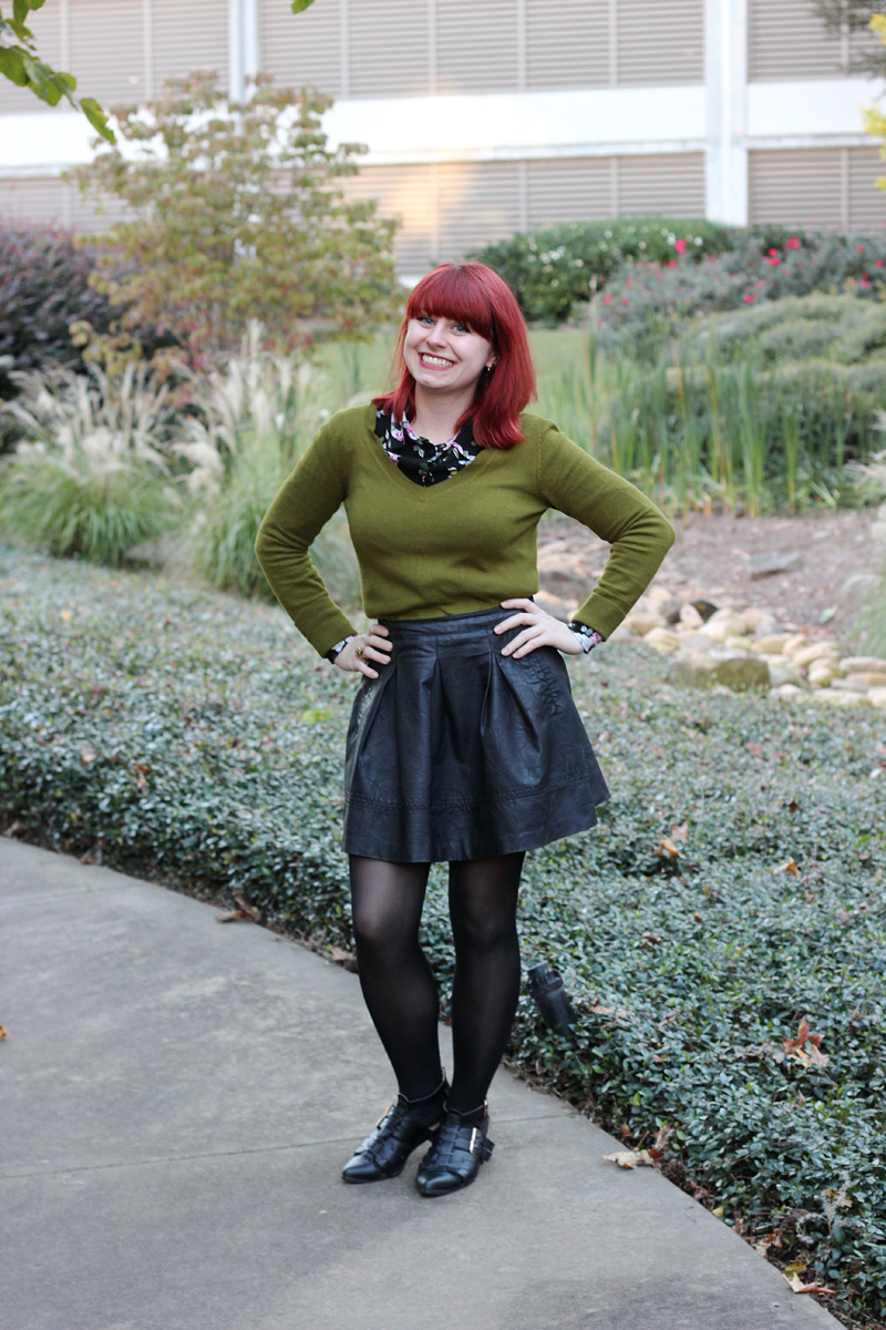 Pleated Leather Skirt, Olive Green V-neck Sweater over a Floral Button Down, and Pointed Cutout Boots