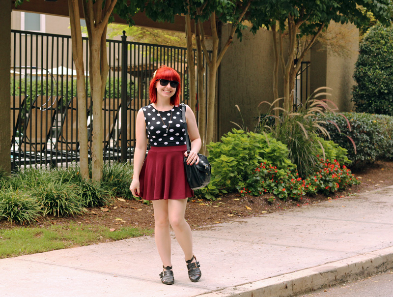 Sleeveless Polka Dot Top, Maroon Skater Skirt, Black Purse, and Cutout Ankle Boots