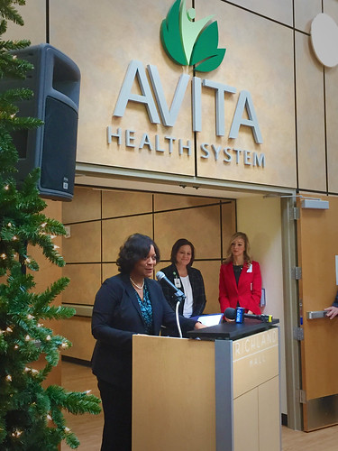 Deputy Under Secretary for Rural Development Vernita Dore at Richland Mall near Avita Health System sign