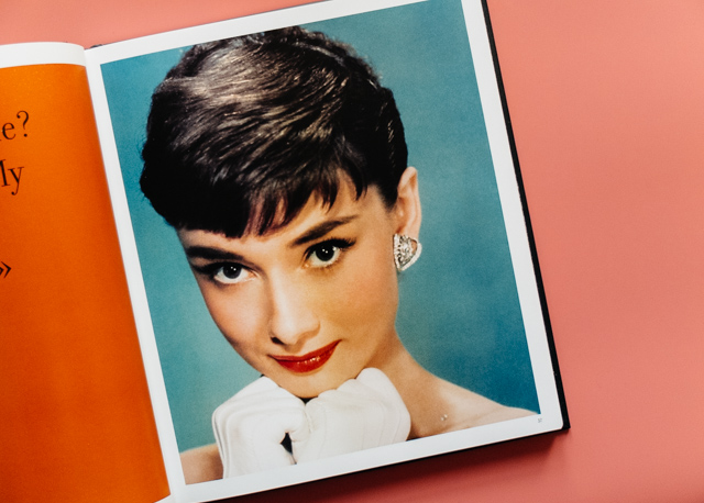 photo of audrey hepburn on turquoise background