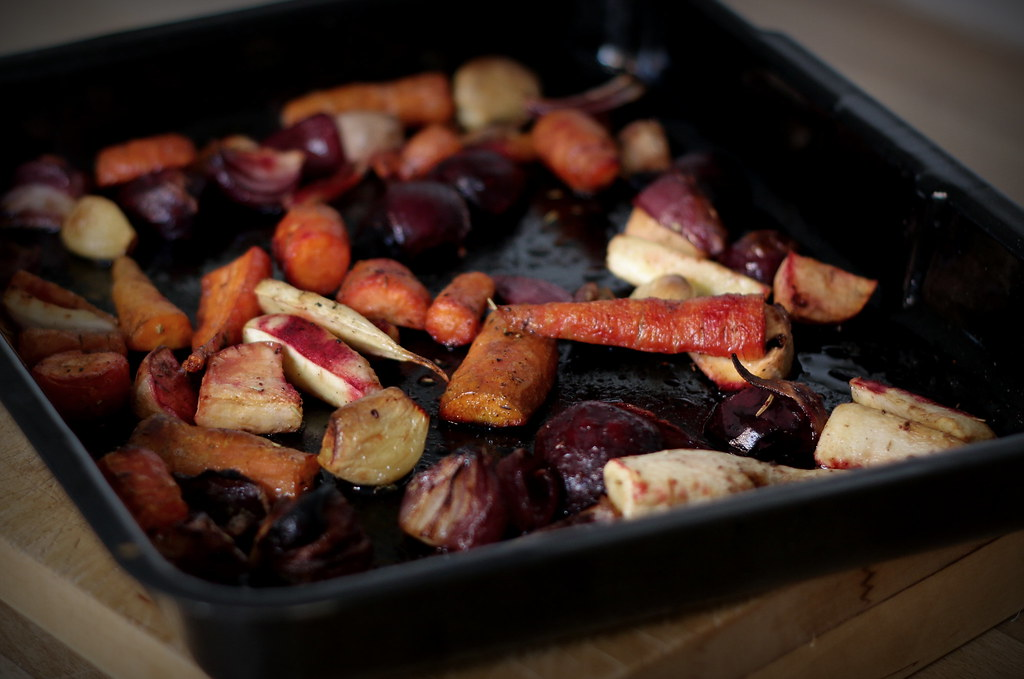 Fruit vinegar roasted root vegetables in baking tin