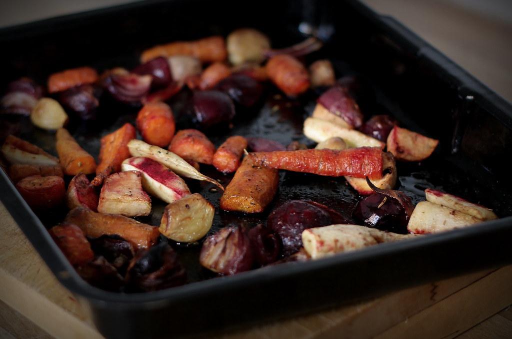 Fruit vinegar roasted root vegetables in baking tin