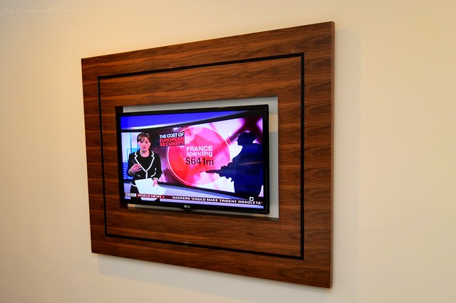 Wooden frame for the wall mounted flat screen TV