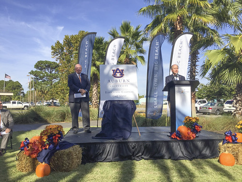 Auburn University Provost Tim Boosinger and City of Gulf Shores Mayor Robert Craft on a platform.