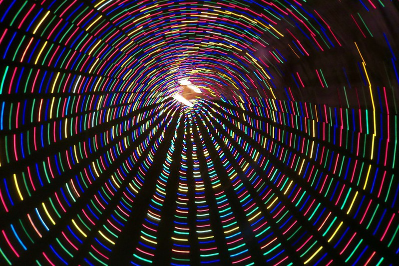 spinning under the christmas tree of lights