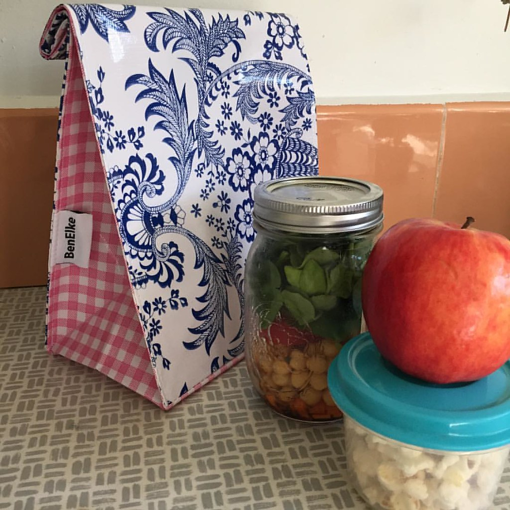 blue and white ben elke lunch bag, ready to be packed with a jar of salad, popcorn and an apple