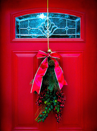 The red door of Rays cabin, all decked out for Christmas