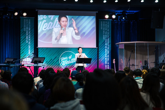 Pastor Erin preaching at a Sunday Service. Photo courtesy of Joel Kim (Oct 2015).