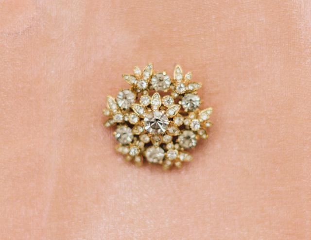 vintage gold brooch with rhinestones