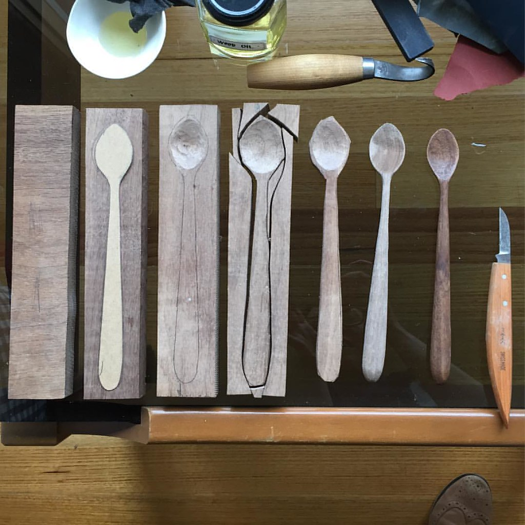 the various steps involved in taking a block of wood and crafting it into a spoon at th craft sessions 2015