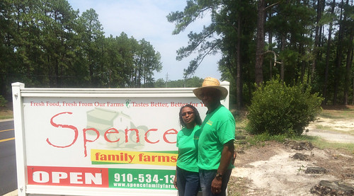 Ed and Sheila Spence in front of their sign