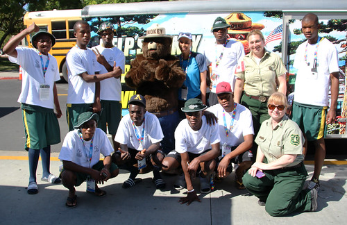 Smokey Bear and U.S. Forest Service employees pose for a picture with the South African team at the World Special Olympics