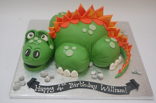 Who'd have thought a dinosaur could be so cuddly? The Delightful Dinosaur Cake - from £70.