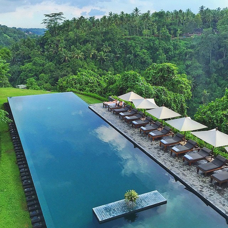 9 luxury resort pools in bali where you can swim in on a for Pool garden mountain resort argao