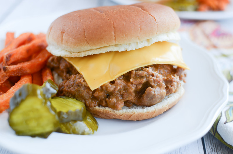 Crockpot Cheeseburgers - sloppy joe style cheeseburgers cooked in the slow cooker. Easy weeknight dinner the whole family will love!