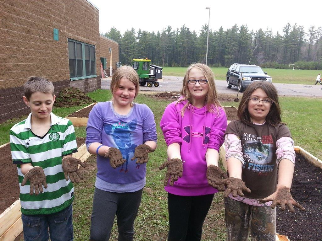 image of kids with soil on their hands