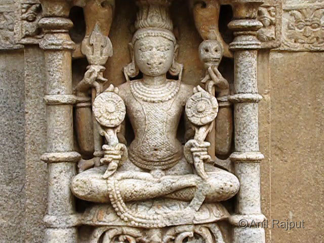 Lord Shiva with scaled snake skin, skull in one hand, Sahastrabahu Temple, Nagda, Udaipur