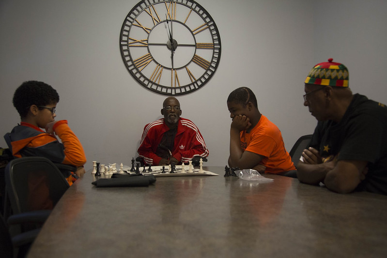 Jamal and Nyshaun are coached by Al Freedman and Charlie Perice-El at their weekly chess club meeting. The club just began this year and will hopefully help the kids in the South Side Communication Center think carefully and critically about all of their actions. | Dominique Hildebrand, Staff Photo
