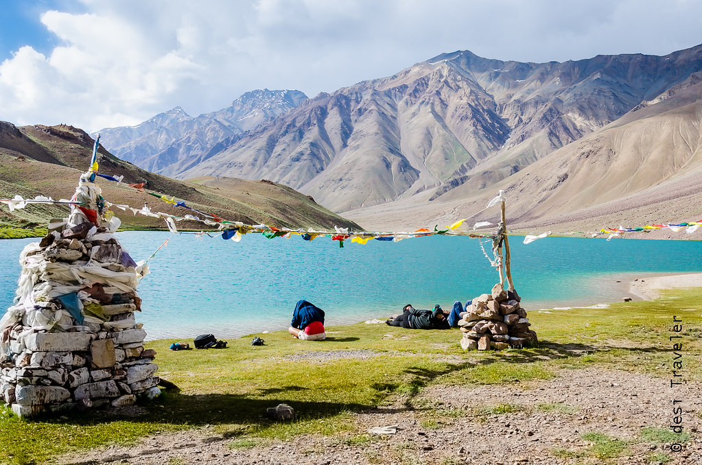 Girl meditating on bank of Chandratal Lake Spiti