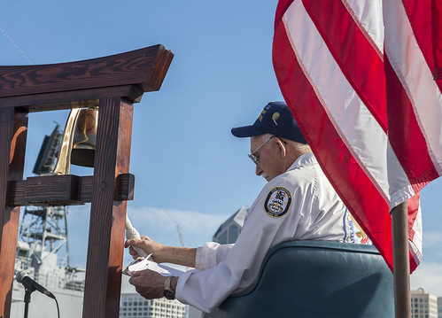 SAN DIEGO - Ben Valeu, a Pearl Harbor survivor, rings a bell during a Pearl Harbor Remembrance Ceremony aboard the USS Midway Museum.