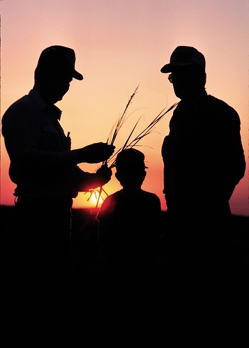 Three generations of farmers at sundown on a South Dakota farm