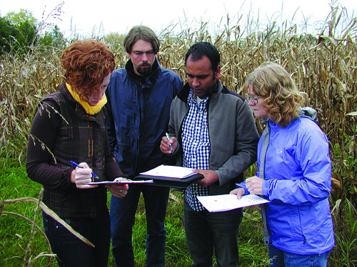 Dr. Morton (R) and her colleagues looking at the layout of one of the more than 35 field sites they are gathering data on