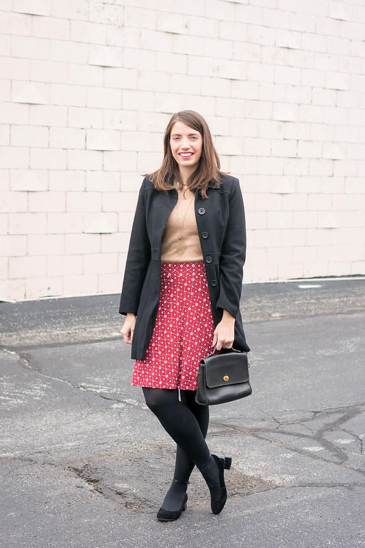black wool coat + tan cashmere sweater + red patterned Loft skirt + black tights | Style On Target blog